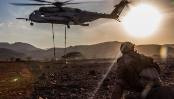 Picture of the Day! US Marine Corps CH-53E Super Stallion Lifts Concrete Barrier in Djibouti