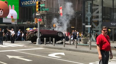 Police arrest a man in Times Square after hitting several pedestrians with his vehicle
