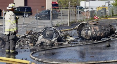 Learjet Crashes Near Building on Landing Approach at Teterboro Airport Near New York City