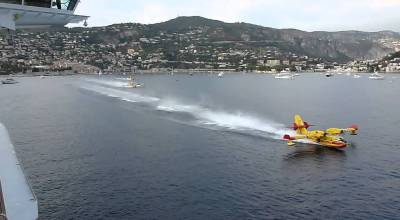 Watch: Fire-fighting water 'Bombers' refilling on the go!