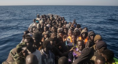 At least 50 migrants drown as smuggler throws them into the sea