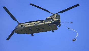 US and Italian army paratroopers exit a CH-47 Chinook helicopter
