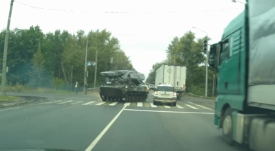 Watch: Russian dashcam shows armored BMD-4 fishtail and punt a civilian SUV in traffic