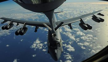 A KC-135 stratotanker assigned to the 465th Air Refueling Squadron refuels a B-52 stratofortress