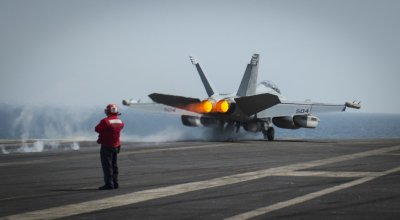 US Navy sailor hit by plane being towed aboard the USS Carl Vinson