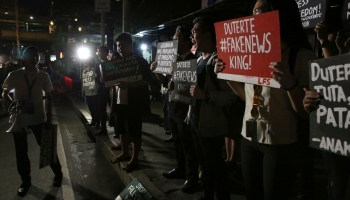 Filipino government escalates to criminal charges against news outlet Rappler