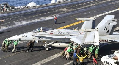 Picture of the Day: How Many Sailors Does it Take to Move a Hornet?