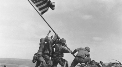 On this day in history: United States Marines raise the American flag atop Mt. Suribachi