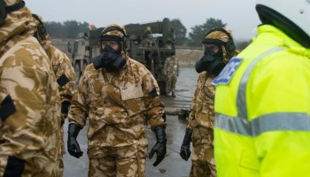 As hundreds of troops respond to nerve agent attack in UK, Theresa May points finger at Russia