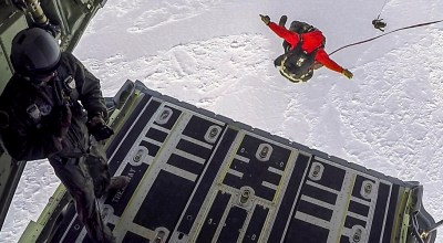 Picture of the Day: Airmen Parachute from an HC-130J Combat King II over the Frozen Beaufort Sea
