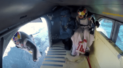 Watch: Wingsuit Flyers Jump Off Cliff and 'Fly' Into an Airplane! Must See!