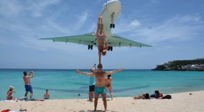 Acrobatic Couple Criticized for Stunt Under Landing Airliner at Maho Beach, Saint Martin
