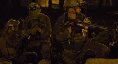 Marine Raiders with 1st Marine Raider Battalion, U.S. Marine Corps Forces, Special Operations Command, transition out of the water during a simulated underwater assault force night-raid in Los Angeles, California, Sept. 3, 2015. Training such as this is conducted to meet Special Operations Forces dive requirements and to enhance the understanding, planning and operational considerations when working in a joint operational environment with both special operations and conventional Marine Corps forces. 1st Marine Raider Battalion is organized, trained and equipped to deploy for worldwide missions as directed by MARSOC in support of their regionally-aligned Theater Special Operations Command. | U.S. Marine Corps photo by Sgt. Scott A Achtemeier