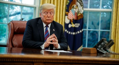 President Donald Trump listens during a phone call with Mexican President Enrique Pena Nieto about a trade agreement between the United States and Mexico, in the Oval Office of the White House, Monday, Aug. 27, 2018, in Washington. | AP Photo/Evan Vucci
