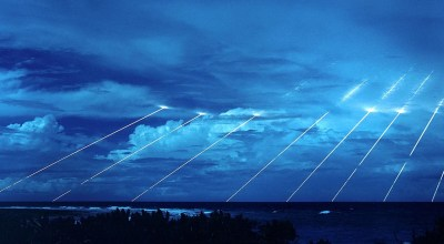 LGM-118A Peacekeeper missile system being tested at the Kwajalein Atoll in the Marshall Islands. This is a long exposure photo showing the paths of the multiple re-entry vehicles deployed by the missile. One Peacekeeper can hold up to 10 nuclear warheads, each independently targeted. Were the warheads armed with a nuclear payload, each would carry with it the explosive power of twenty-five Hiroshima-sized weapons which is equivalent to around 400 kilotons of TNT.