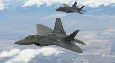 An F-22 and an F-35, flown by Air Force Reserve Command pilots from the 514th Flight Test Squadron here fly over the Utah Test and Training Range during a functional check flight approximately 75 miles west of Hill AFB. (Air Force photo)