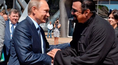 Russian President Vladimir Putin, left, and U.S. actor Steven Seagal shake hands after visiting an oceanarium built on Russky Island, where the Eastern Economic Forum takes place, in Russian Far Eastern port of Vladivostok, Russia, Friday, Sept. 4, 2015. (AP Photo/RIA Novosti, Alexei Druzhinin, Presidential Press Service)