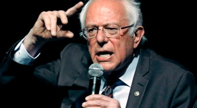 """In this April 4, 2018, file photo, Sen. Bernie Sanders, I-Vt., responds to a question during a town hall meeting in Jackson, Miss. Sanders' """"Medicare for all"""" plan would increase government health care spending by $32.6 trillion over 10 years, according to a study by a university-based libertarian policy center. (AP Photo/Rogelio V. Solis, File)."""