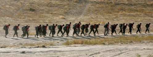 Afghan Commandos and U.S. soldiers march with weighted rucksacks during a ten-day course at a Commando training camp in Afghanistan's Wardak province Friday, Oct. 2, 2009. The commandos are competing for a chance to become instructors for incoming members of the elite force. Three Americans are training along with their Afghan counterparts as preparation for Special Forces selection back home. (AP Photo/Maya Alleruzzo)