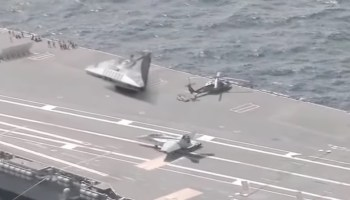This video of a UFO parked aboard a US aircraft carrier is making its way around the media (and is obviously fake)