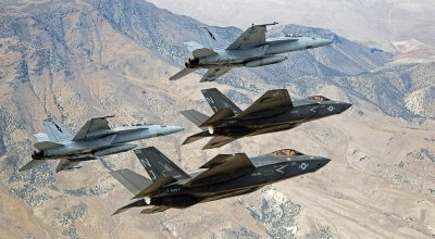 F-35C Lightning IIs, attached to the Grim Reapers of Strike Fighter Squadron 101, and F/A-18E/F Super Hornets attached to the Naval Aviation Warfighter Development Center fly over Naval Air Station Fallon's Range Training Complex on Sept. 3, 2015. (U.S. Navy photo by Lt. Cmdr. Darin Russell)