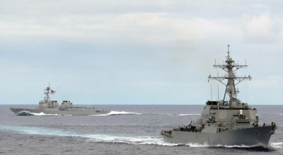 The US Navy (USN) Arleigh Burke Class (Flight II) Guided Missile Destroyer (Aegis) USS DECATUR (DDG 73) (foreground), and the USN Arleigh Burke Class (Flight IIA) Guided Missile Destroyer (Aegis) USS McCAMPBELL (DDG 85) execute maneuvers during a sea power demonstration conducted while on deployment in the Pacific Ocean (US Navy)