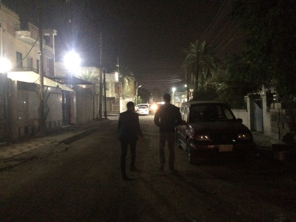 Just after a late night haircut, using a back road in Basra, Iraq to get home.