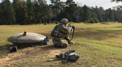 A Soldier from Bravo troop 2-108th cavalry squadron prepares to engage targets from the kneeling position/ Joseph Lafave for NEWSREP