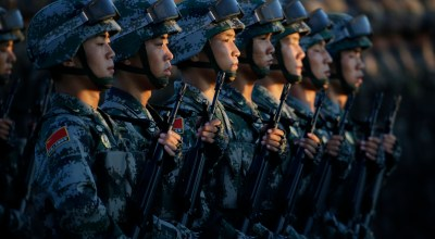 BEIJING, CHINA - SEPTEMBER 03: Soldiers of China's People Liberation Army (PLA) prepare in front of the Tiananmen Gate ahead of the military parade to mark the 70th Anniversary of the end of World War Two on September 3, 2015 in Beijing, China. China is marking the 70th anniversary of the end of World War II and its role in defeating Japan with a new national holiday and a military parade in Beijing. (Photo by Jason Lee - Pool/Getty Images)