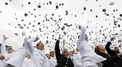ANNAPOLIS, MD - MAY 24: (AFP OUT) Midshipmen celebrate at the end of the U.S. Naval Academy Graduation and Commissioning ceremonies May 24, 2013 in Annapolis, Maryland. In President Barack Obama's speech at the graduation he addressed the rising number of sexual assaults reported in the military.  (Photo by Molly Riley-Pool/Getty Images)