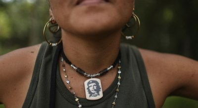 FARC (Revolutionary Armed Forces of Colombia) rebel Gina poses while wearing a Che Guevara necklace following the 10th Guerrilla Conference in the remote Yari plains where the peace accord was ratified by the FARC on September 25, 2016 in El Diamante, Colombia. /Photo by Mario Tama/Getty Images