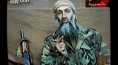 """A videotape released by Al Jazeera TV featuring Osama Bin Laden is broadcast in Britain December 27, 2001. The tape, recorded an estimated two weeks earlier, shows bin Laden describing the World Trade Center attack as """"commendable,"""" calling it """"benevolent terrorism"""" designed to raise the issue of Israeli attacks on Palestinians. (Getty Images)"""