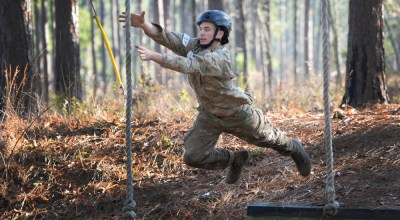 A Special Forces candidate at the U.S. Army John F. Kennedy Special Warfare Center and School jumps onto a rope on Nasty Nick, the school's legendary obstacle course, during Special Forces Assessment and Selection (SFAS) at Camp Mackall, North Carolina, Jan. 16, 2019. The candidates who attended the three-week assessment were evaluated on their ability to work individually and as a team by using four broad dimensions of assessment, intellect, social, character and physical stamina, which are interwoven and evaluated throughout SFAS. (U.S. Army photo by K. Kassens)