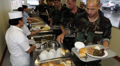Students from Basic Underwater Demolition/SEAL Class 285 are served lunch for the first time at the grand opening of the Naval Special Warfare Basic Training Command Oceanside BUD/S Galley at Naval Amphibious Base Coronado, California. (Photo by Kyle Gahlau, DVIDS)