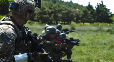 Bulgarian Special Forces and U.S. Army Green Berets assigned to the 20th Special Forces Group (Airborne) provide security during a combined air assault operation June 18, 2019, as part of Exercise Trojan Footprint 19 near Yambol, Bulgaria. (U.S. Army photo by Sgt. 1st Class Whitney Hughes, U.S. Special Operations Command Europe Public Affairs)