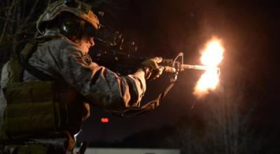 Airman 1st Class Sean Carnes, a 1st Combat Camera Squadron combat photojournalist, fires an M4 carbine rifle as part of tactics training in exercise Scorpion Lens 2016 at Fort Jackson, S.C., March 7, 2016. The exercise is twofold containing the Scorpion Lens portion, which is dedicated to advanced weapons and tactical training, and the flash bang portion, which practices photography and videography documentation standards in combat situations. The purpose of the training is to provide refresher training to combat camera personnel. (U.S. Air Force photo/Staff Sgt. Jonathan Snyder).