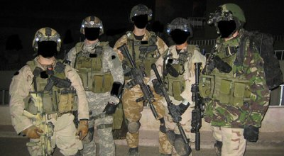 SAS and Special Forces Support Group (SFSG) operators during nighttime operations in Iraq. (Image courtesy of YouTube.com).