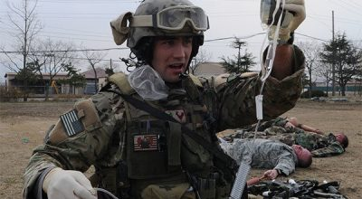 A Pararescueman with the 320th Special Tactics Squadron prepares intravenous fluids during a a training exercise. (Image courtesy of AFSOC).