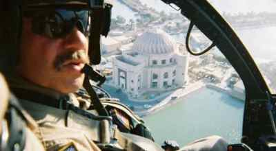 "(CWO4 Greg ""Gravy"" Cocker pilots his Night Stalker gunship over Baghdad)"