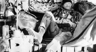 (Author's favorite photo of Guido relaxing momentarily in the back of a 6x6 Austrian Pinzgauer all-terrain vehicle in the Jordanian desert.)