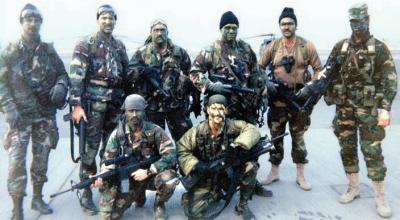 """ODA-525, the Sharkmen just prior to deploying out to the Iraqi desert. (Photo courtesy of Robert """"Blade"""" Gardner, third from the left in back row)"""