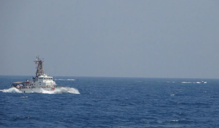 Two Iranian fast-attack boats approach the Coast Guard cutter Maui at high speed in the Strait of Hormuz on Monday.