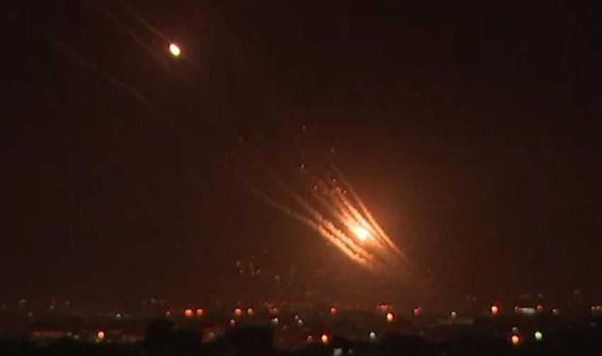 Israeli Iron Dome missiles target incoming rockets from Gaza over the city of Jerusalem.