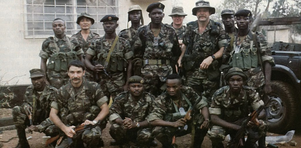 Lt. Col. Robert C. MacKenzie (standing, wings on hat) with the Sierra Leone Commandos he was training with the Gurkha Security Guards. Lt. Andy Myers is second from left, kneeling.
