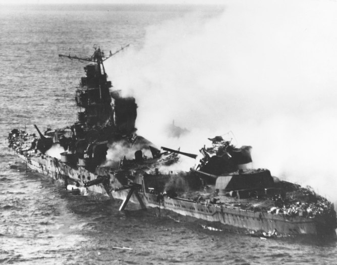 Japanese heavy cruiser Mikuna after being devastated by American dive bombers in the Battle of Midway.