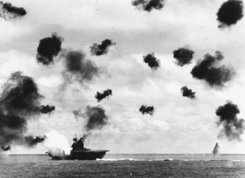 The USS Yorktown is hit by Japanese airstrikes during the Battle of Midway.