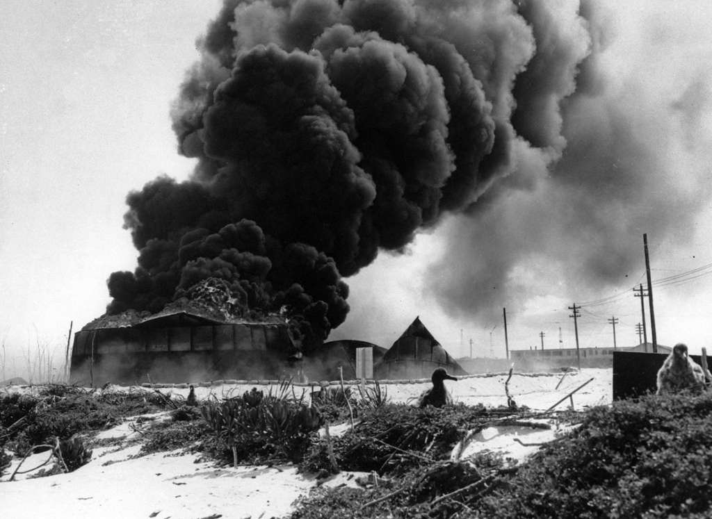 American defenses burn on the Island of Midway after the Japanese attack.