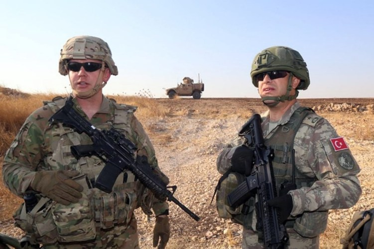 A Turkish and an American troop.