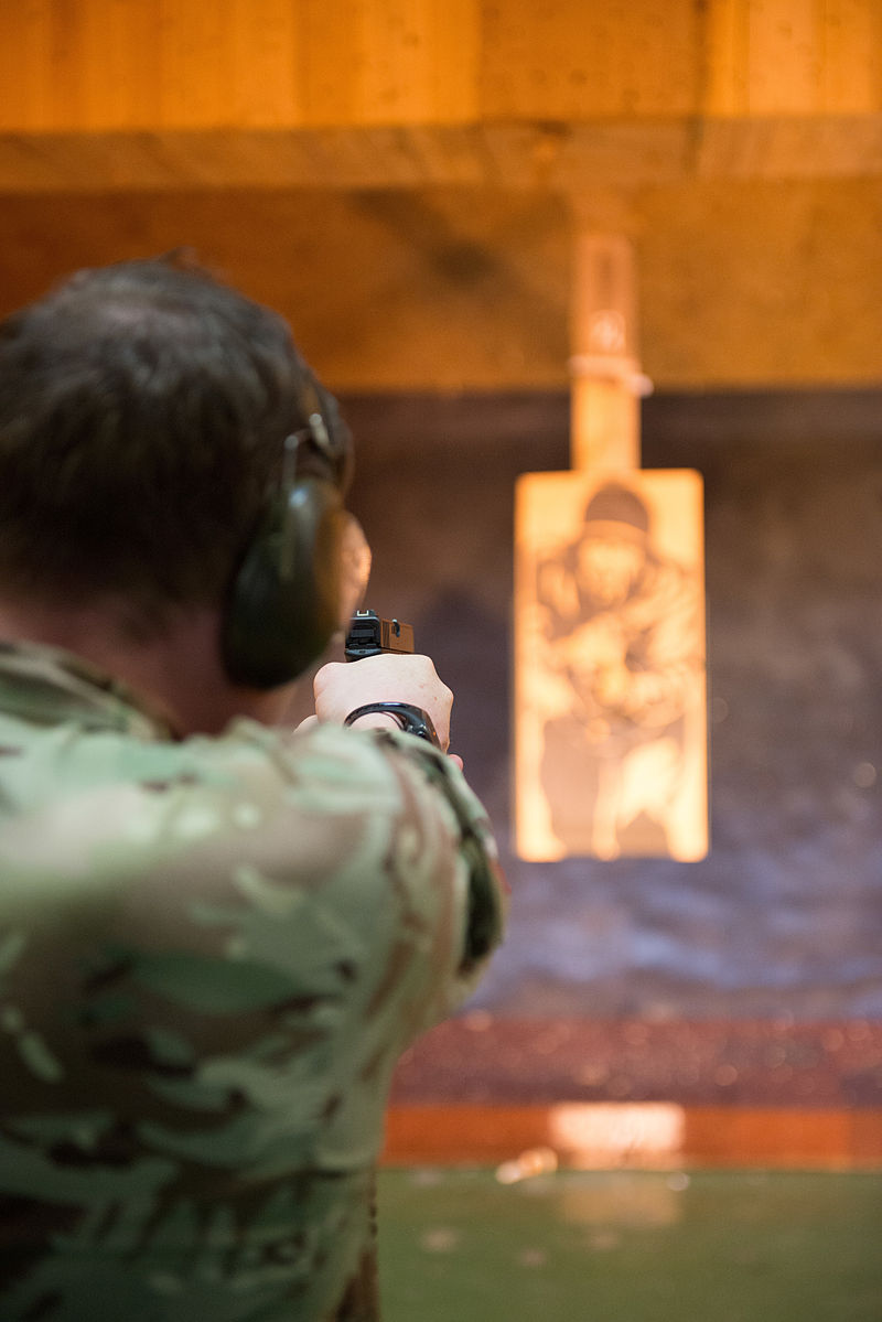 British Military Police Airman Cpl. Stephen Haggarty, assigned at Ramstein Air Base, shoots with his Glock pistol at the U.S. Army Training Support Center Benelux 25-meter indoor range on Chièvres Air Base, Belgium, April 13, 2015. British forces assigned to different units in NATO or SHAPE trained under supervision of the British Joint European Training Team. (U.S. Army photo by Visual Information Specialist Pierre-Etienne Courtejoie / Released)