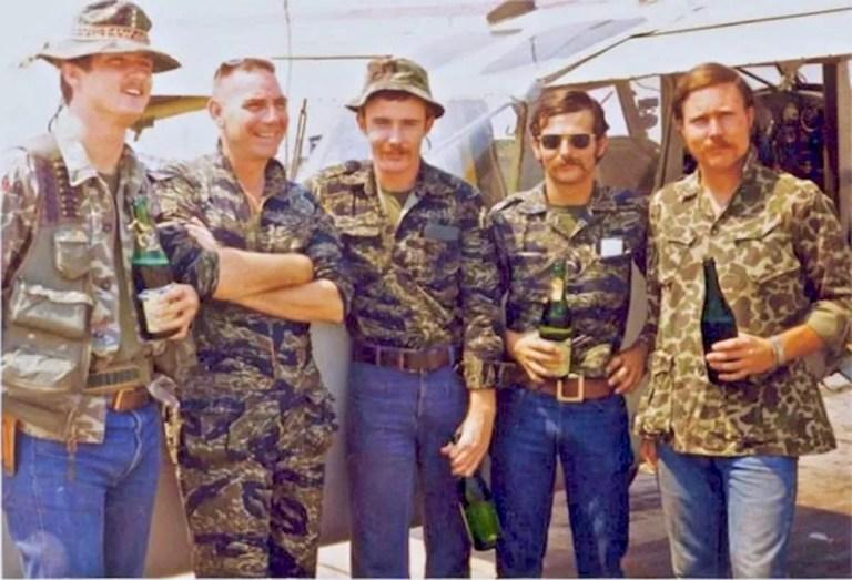 Navy SEALs in Vietnam wearing tiger-stripe uniforms